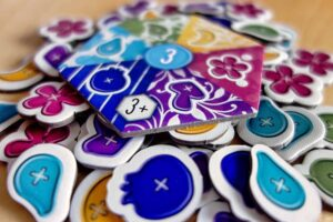 Button tokens of the game Calico